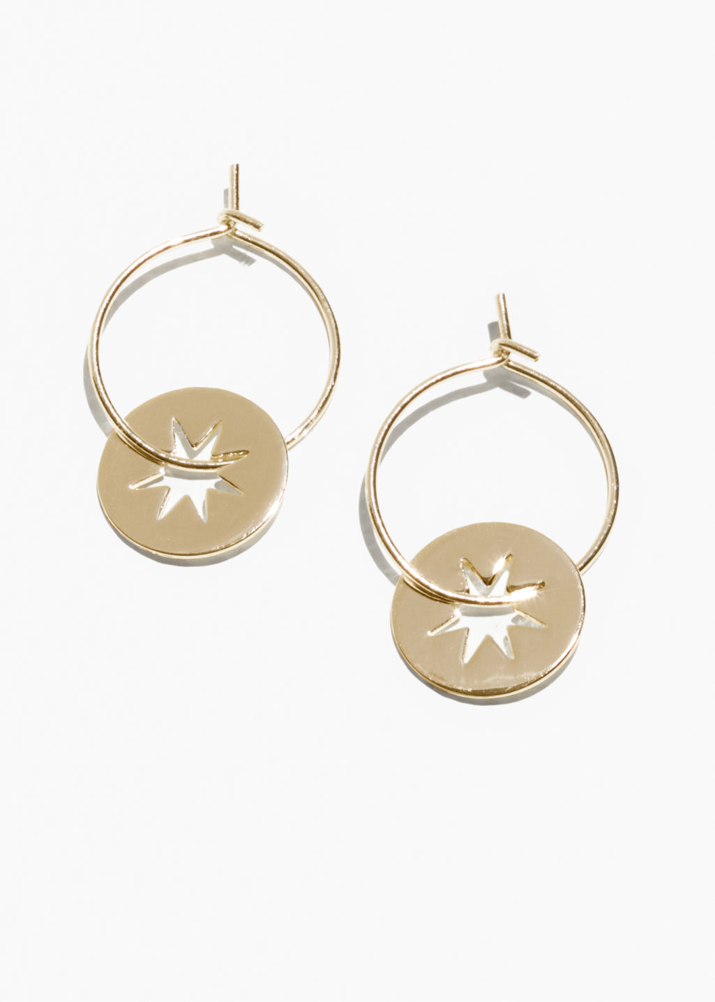 Front image of Stories star charm hoop earrings in gold