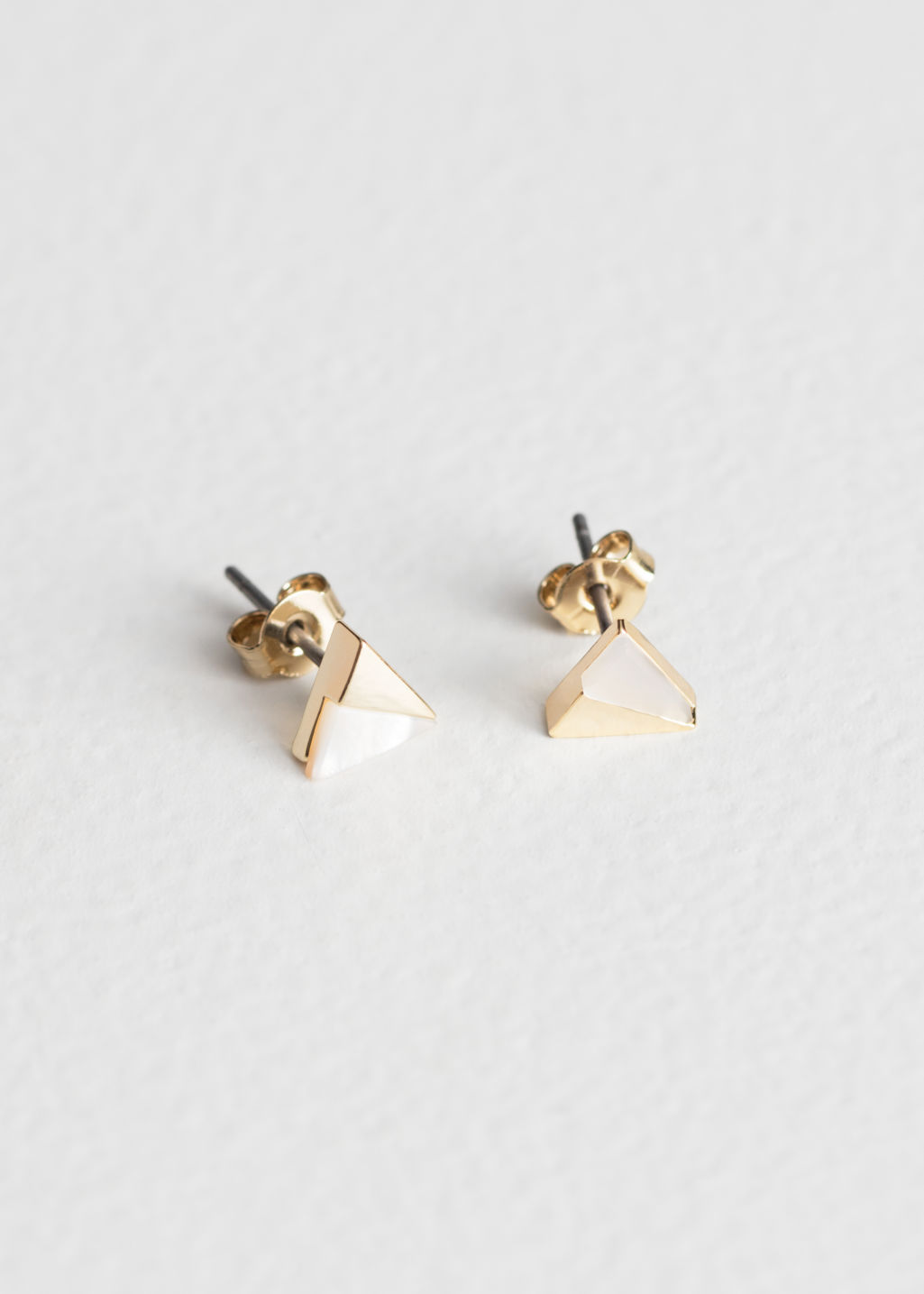 Front image of Stories duo triangle studs  in white