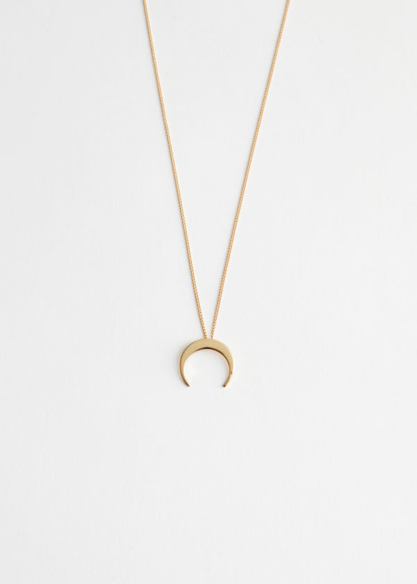 Front image of Stories crescent moon necklace in gold