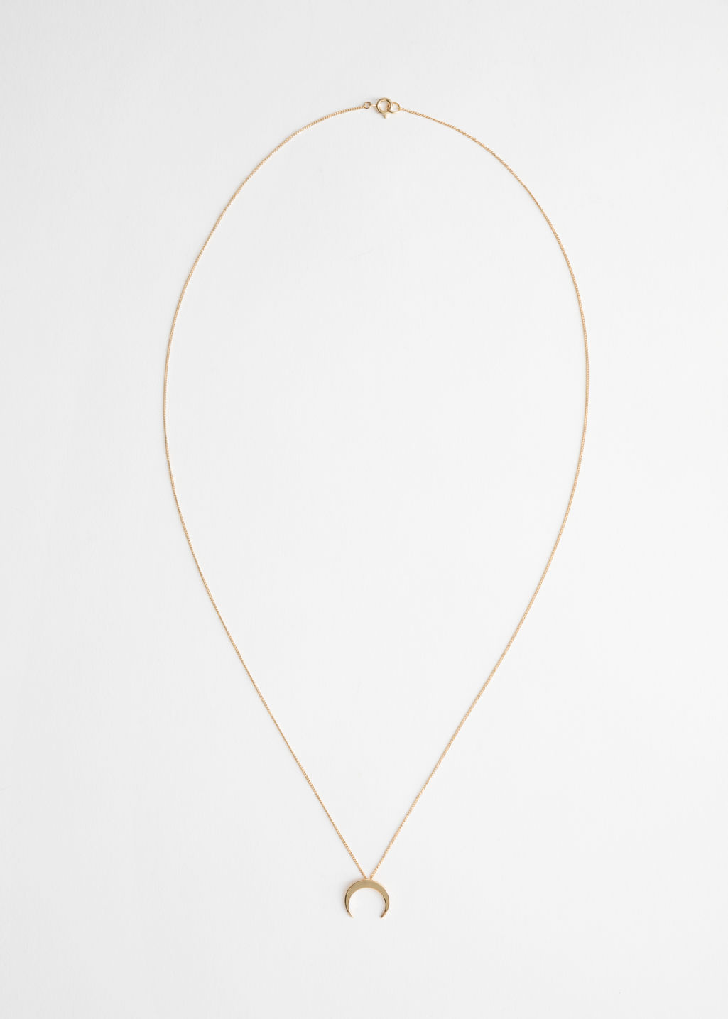 Back image of Stories crescent moon necklace in gold