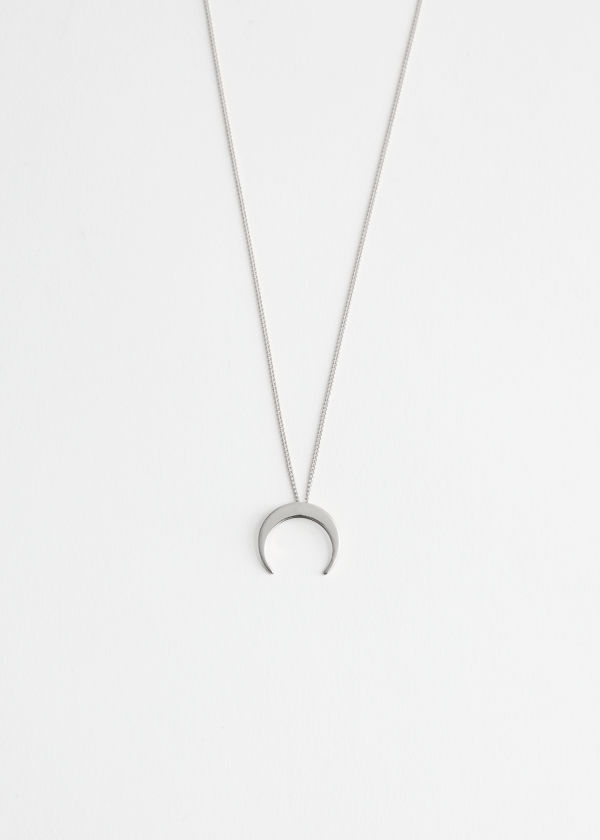 Front image of Stories crescent moon necklace in silver