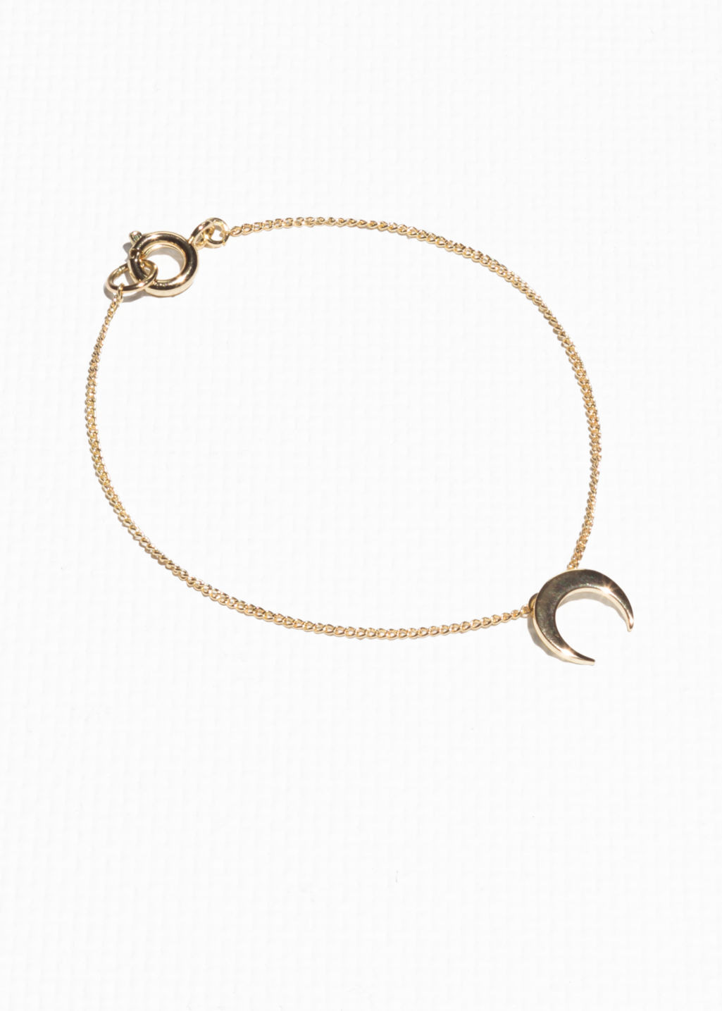 Front image of Stories crescent moon bracelet in gold