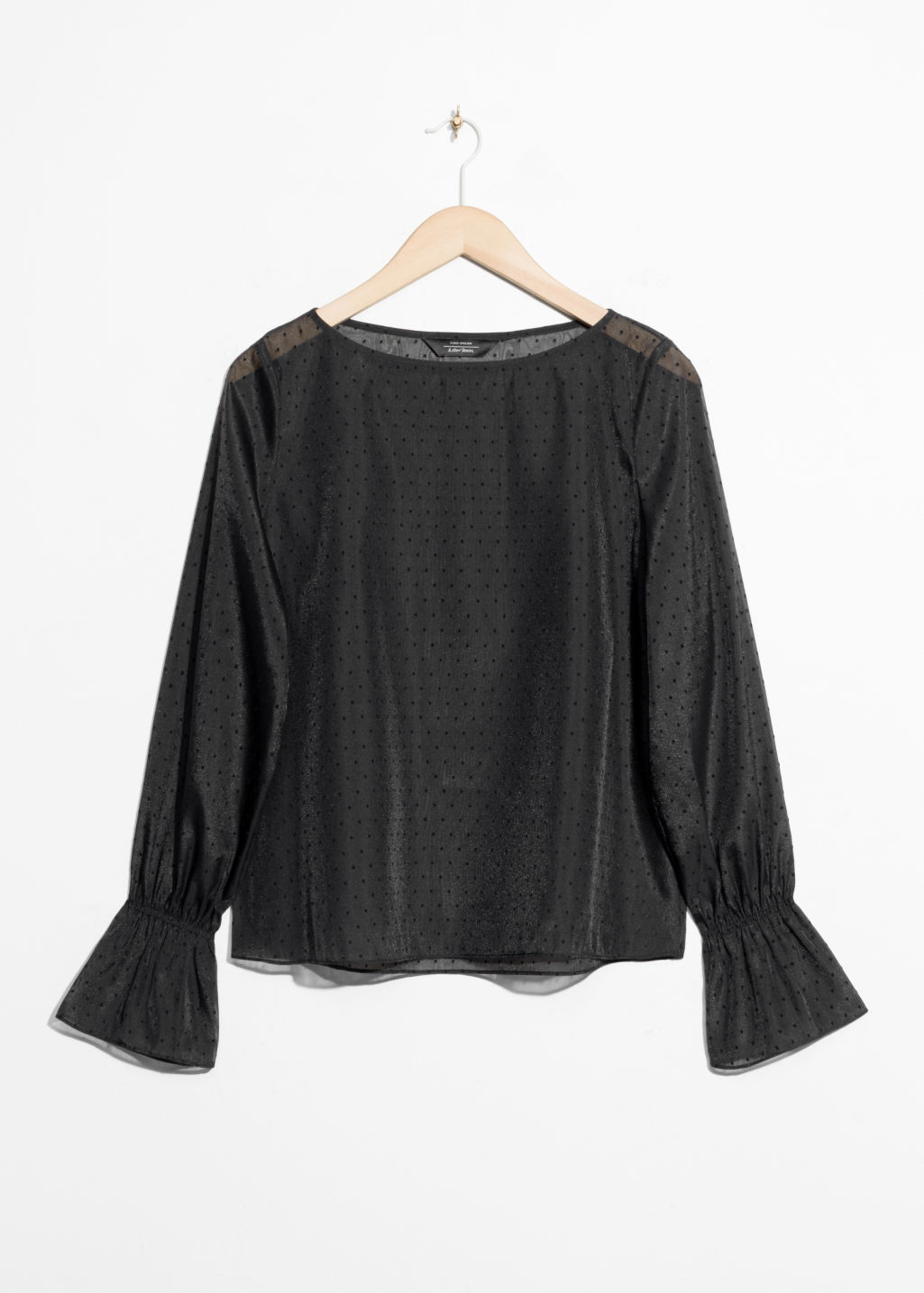 Front image of Stories trumpet sleeve top in black