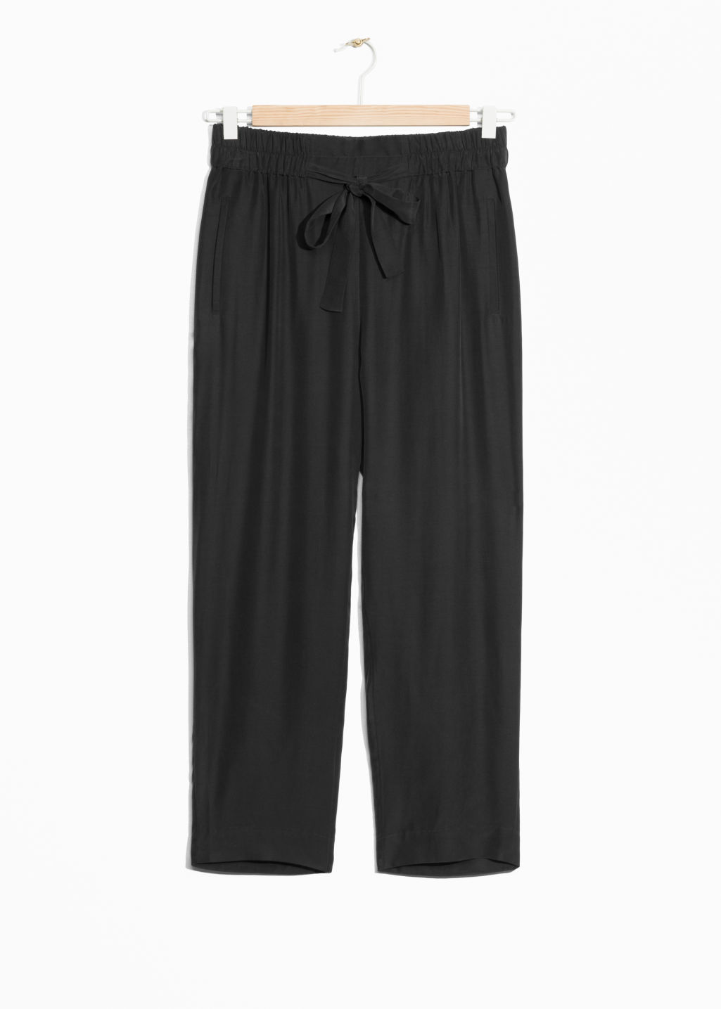 Front image of Stories dressed cupro joggers in black