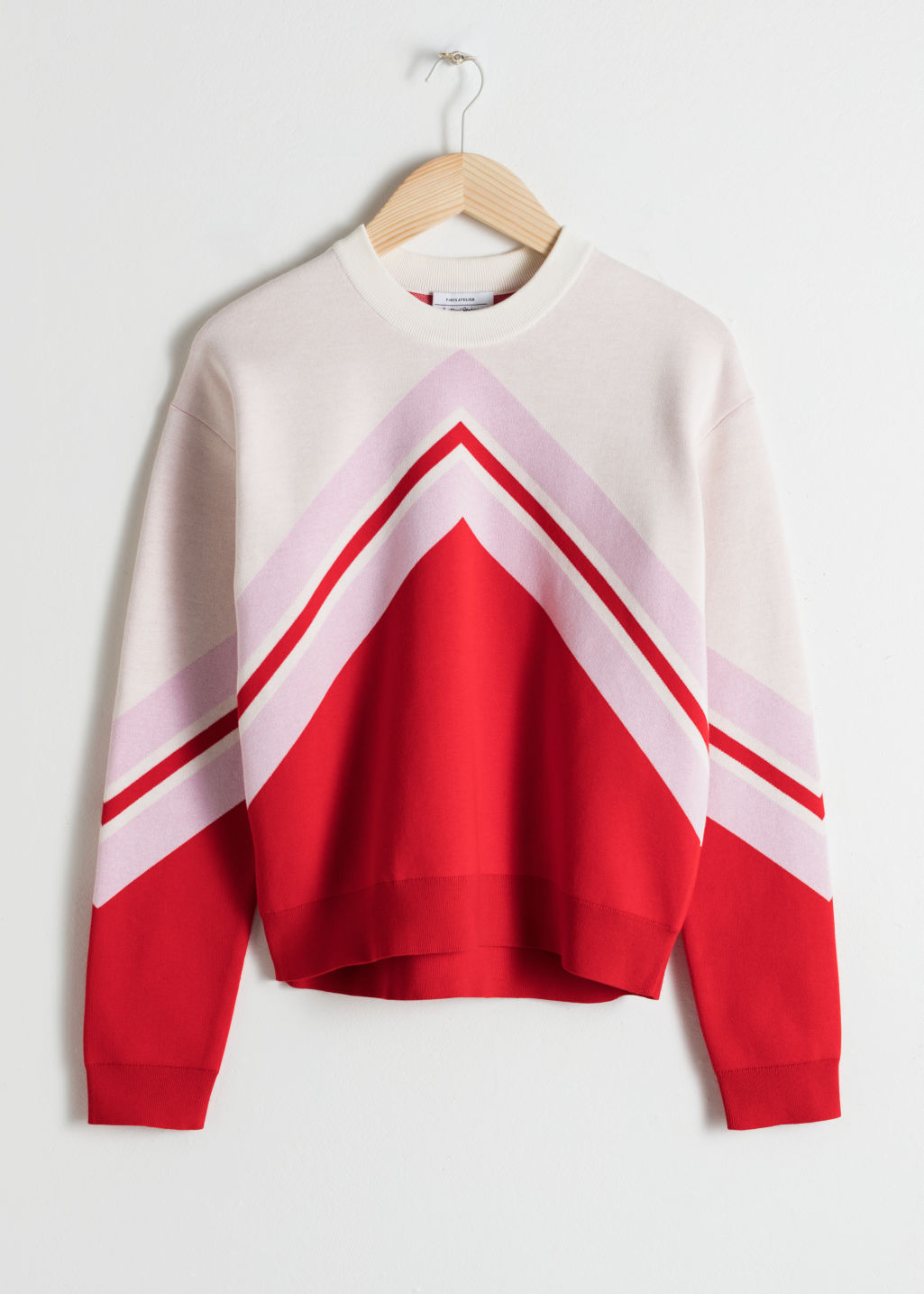 Front image of Stories varsity knit sweater in red