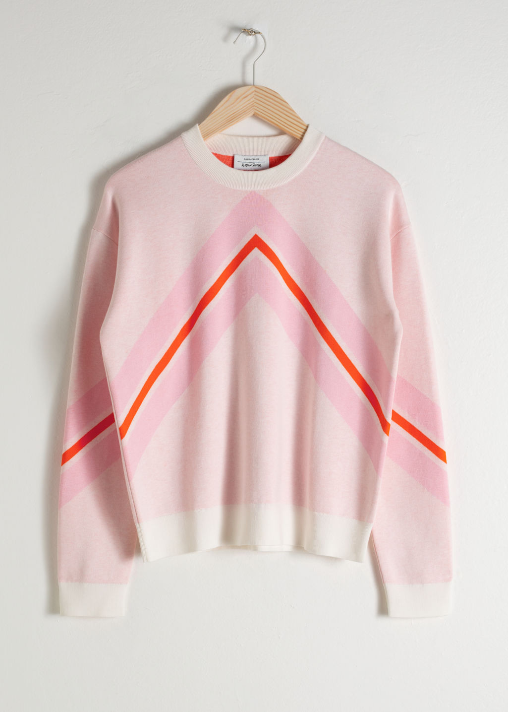 Front image of Stories varsity knit sweater in pink