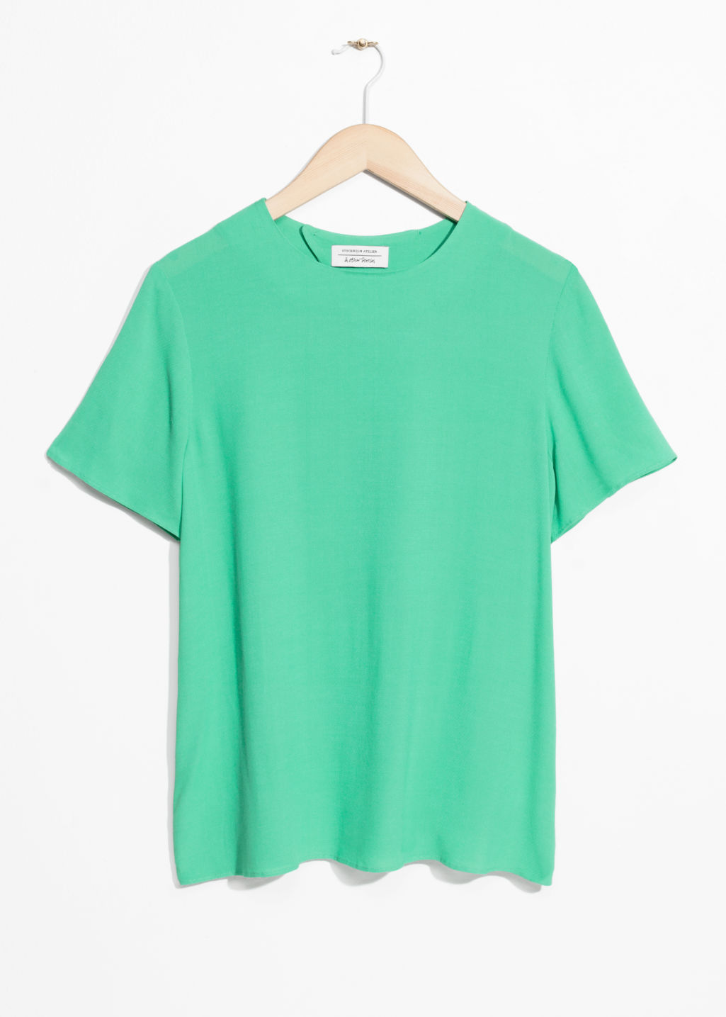 Front image of Stories loose top  in green