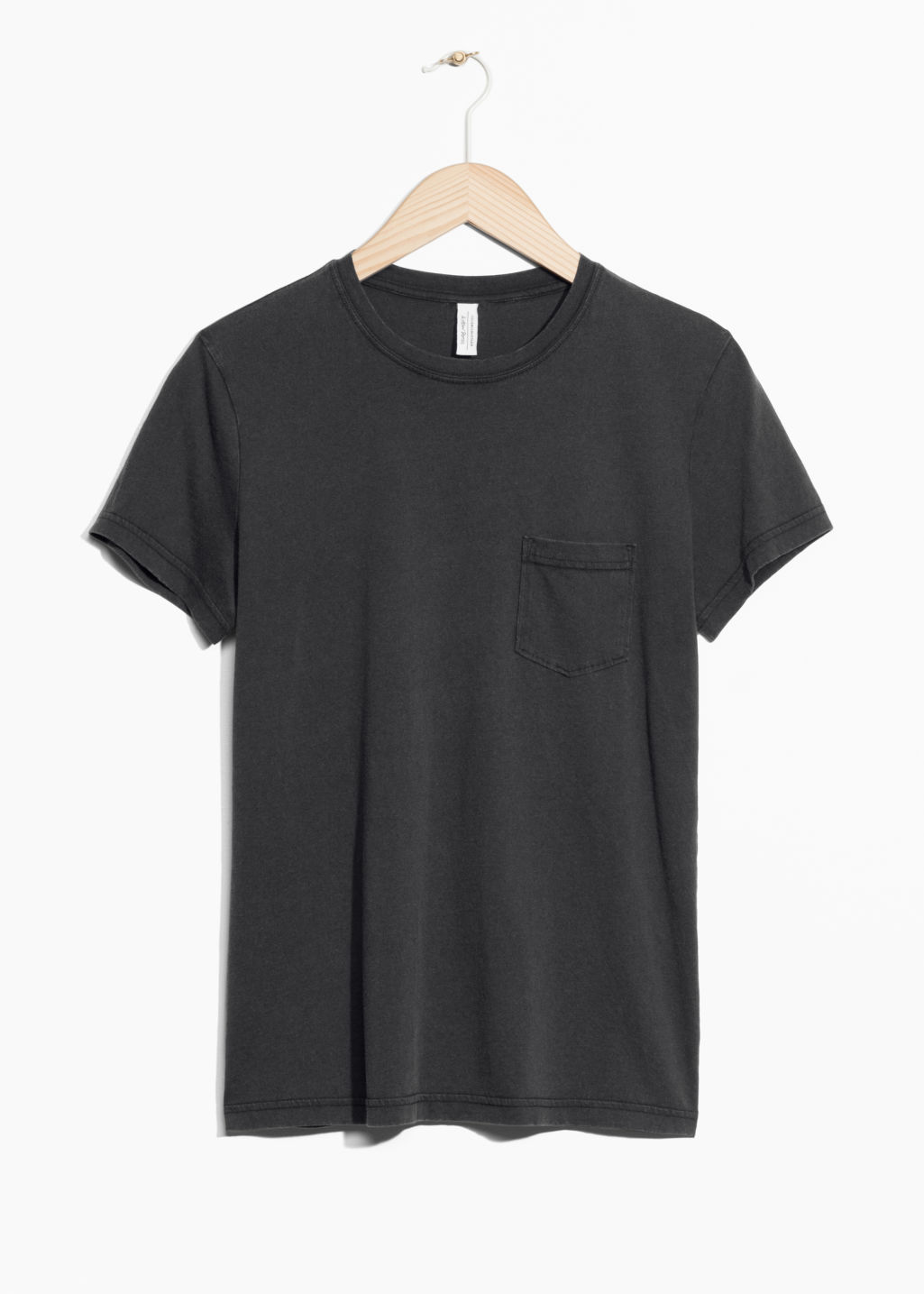 Front image of Stories pocket t-shirt in black