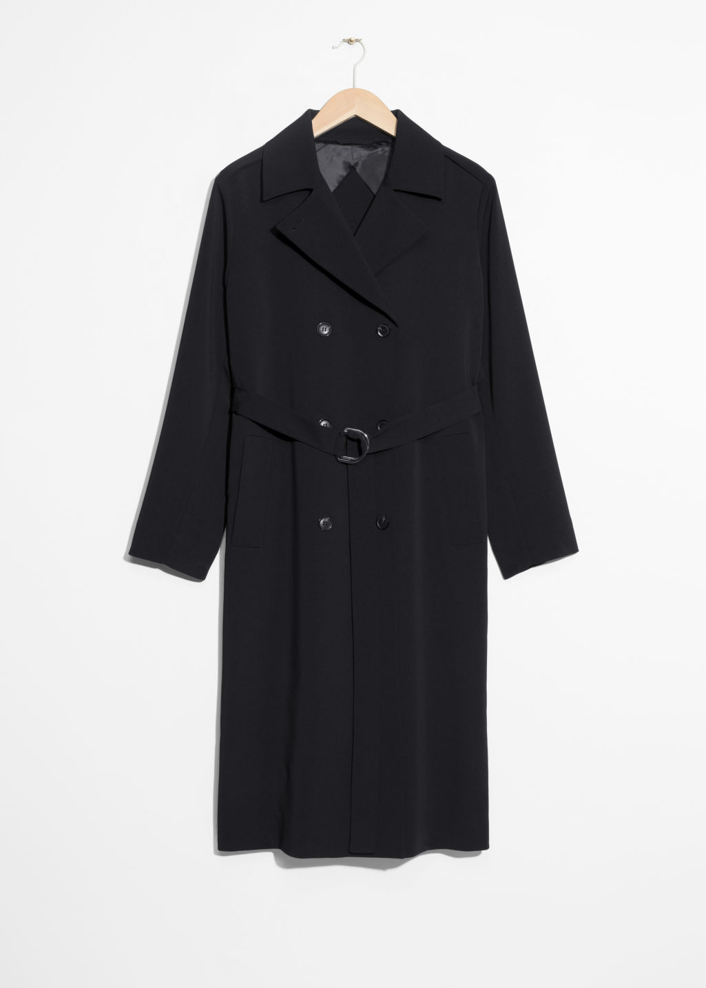 Front image of Stories double breasted trench coat in black