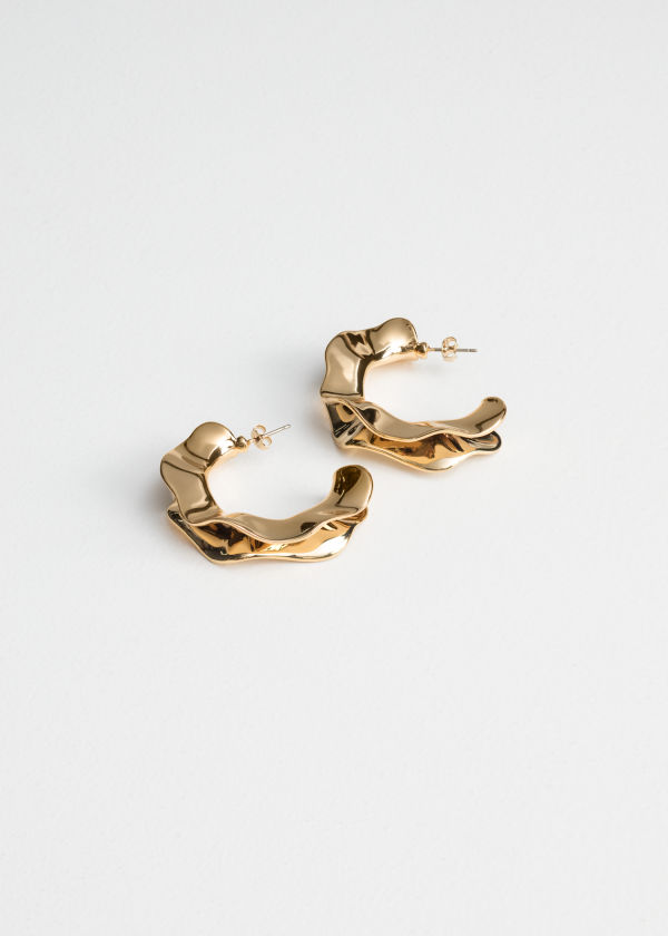Front image of Stories rippling waves hoop earrings in gold