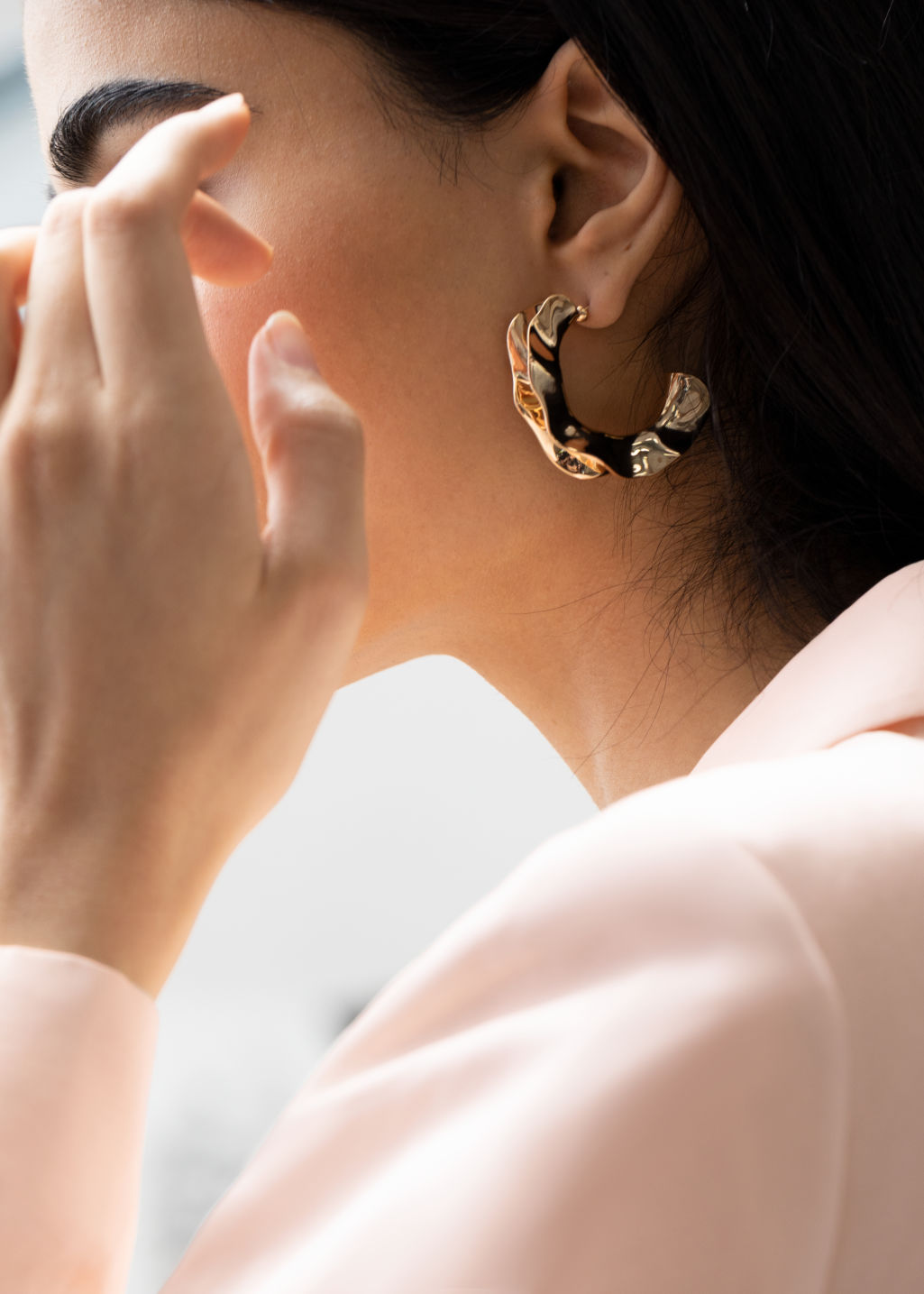 Back image of Stories rippling wave hoop earrings in gold