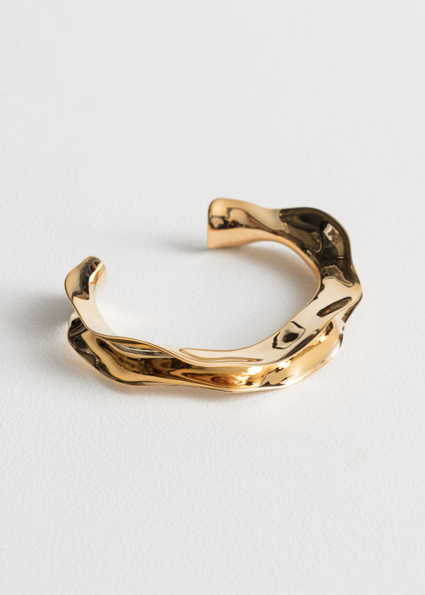 Front image of Stories rippling waves cuff in gold