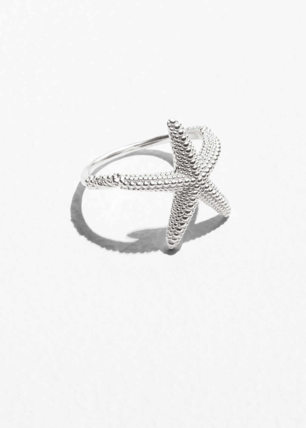 Front image of Stories star fish ring in silver
