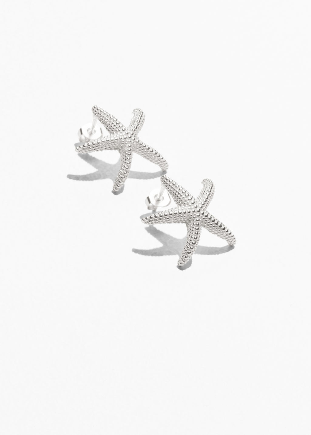 Front image of Stories star fish stud earrings in silver