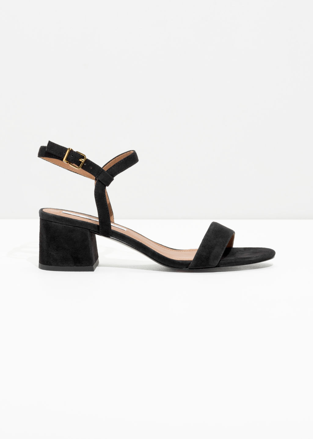 Front image of Stories mid heel sandals in black