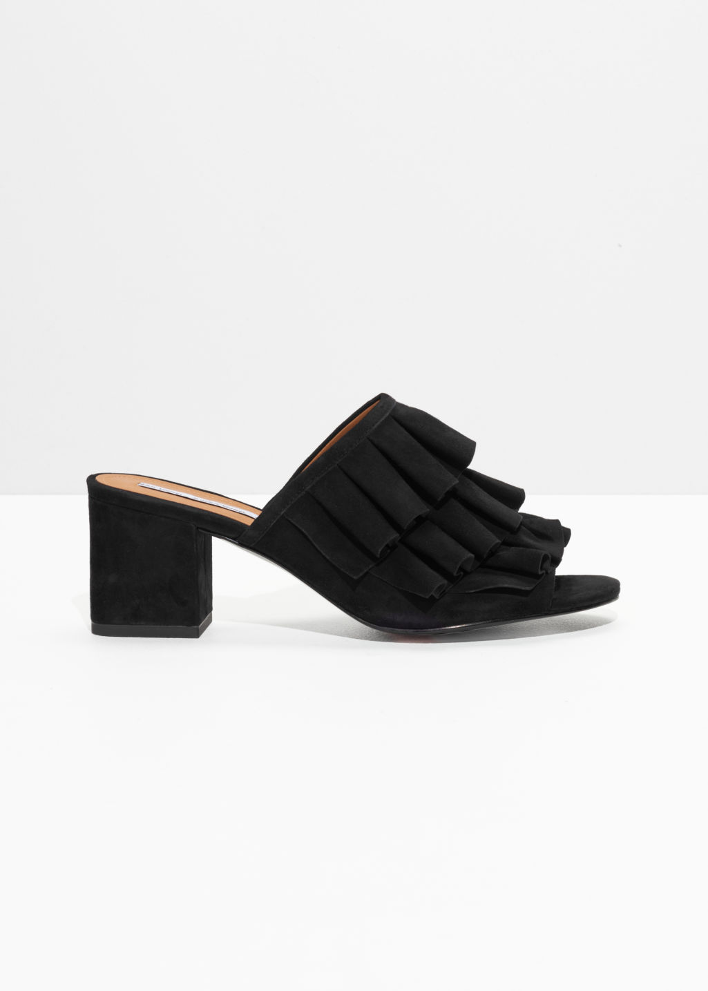 Front image of Stories flounce suede mules in black