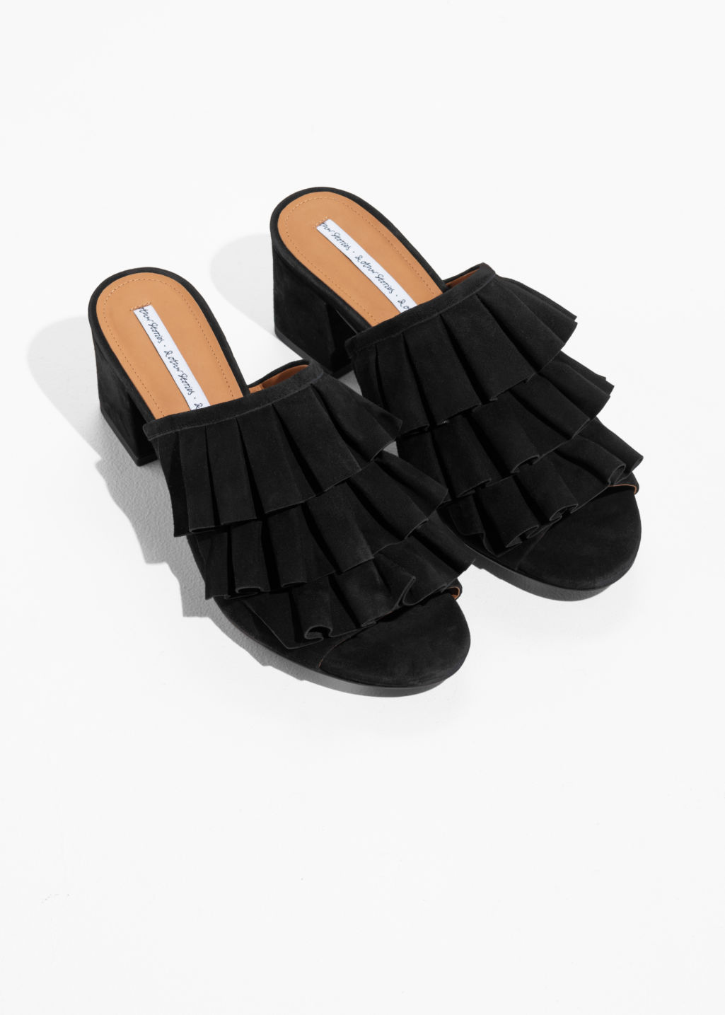 Back image of Stories flounce suede mules in black