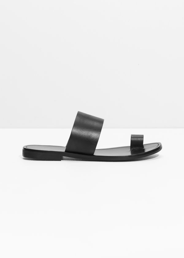 Front image of Stories toe strap sandals in black