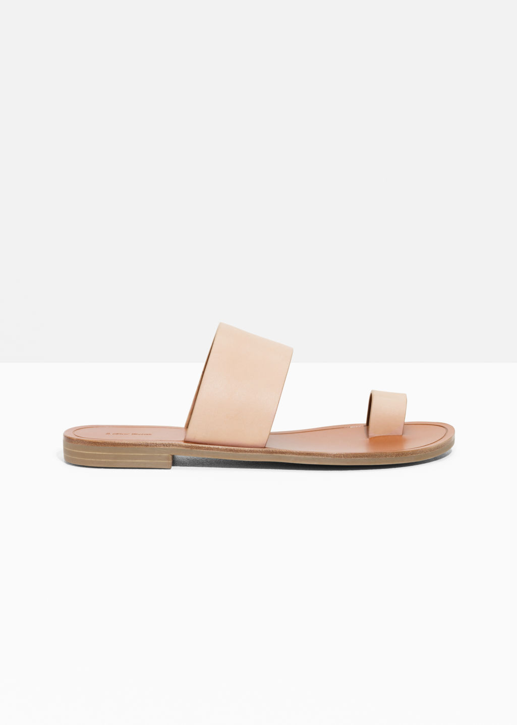 Front image of Stories toe strap sandals in beige