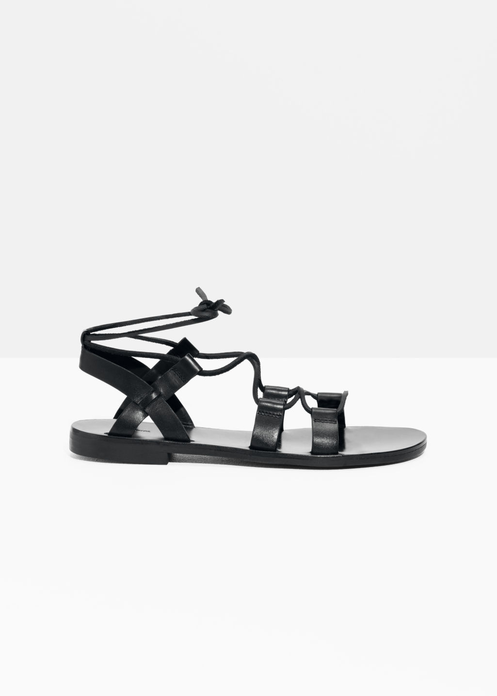 Front image of Stories strappy gladiator sandals in black