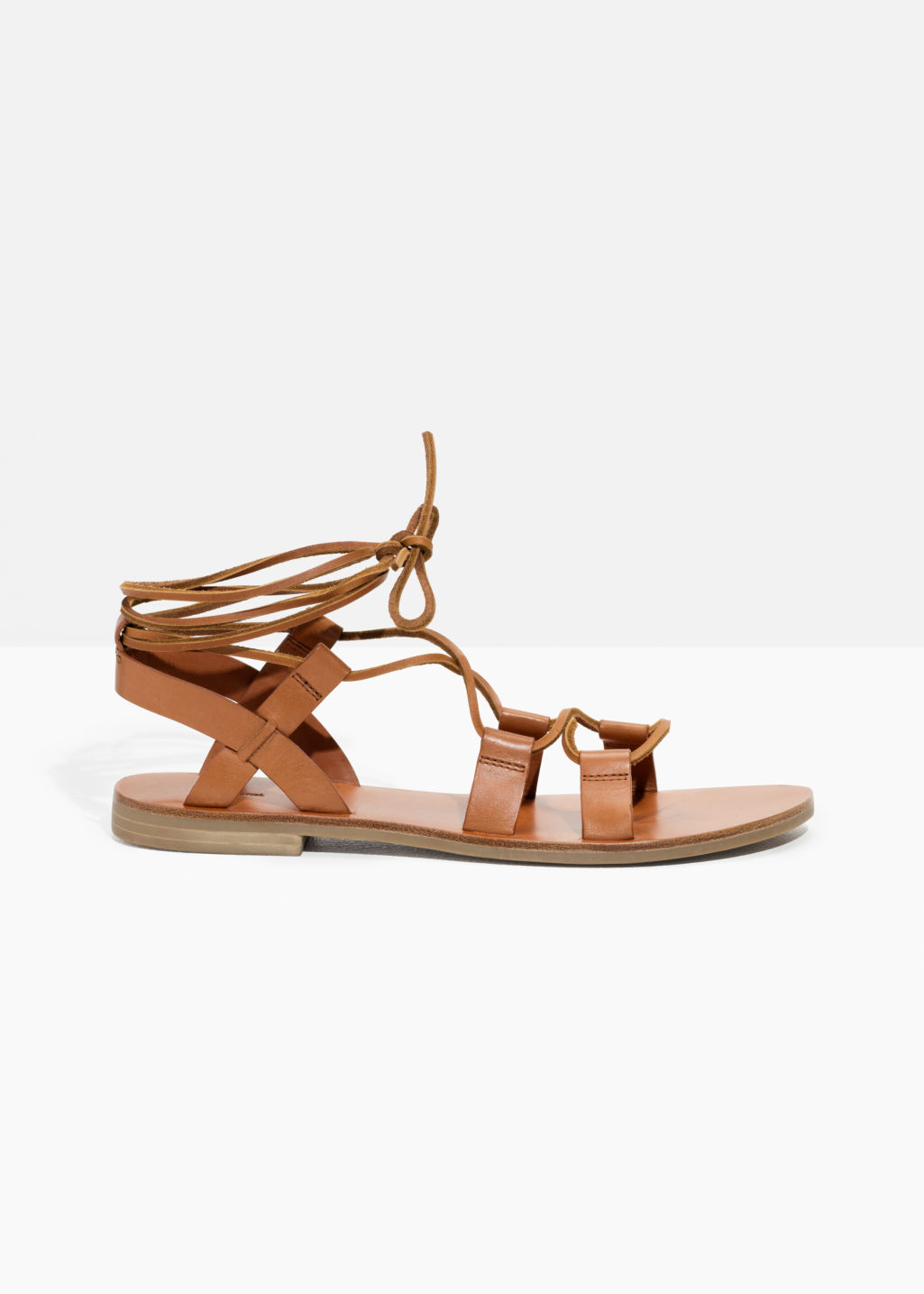 Front image of Stories strappy gladiator sandals in orange