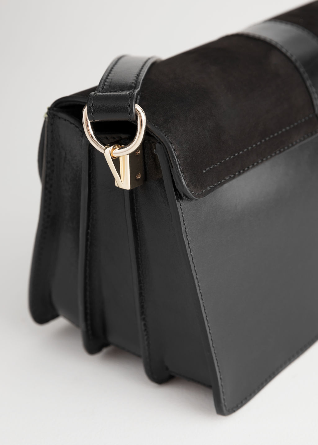 Back image of Stories leather crossover bag  in black