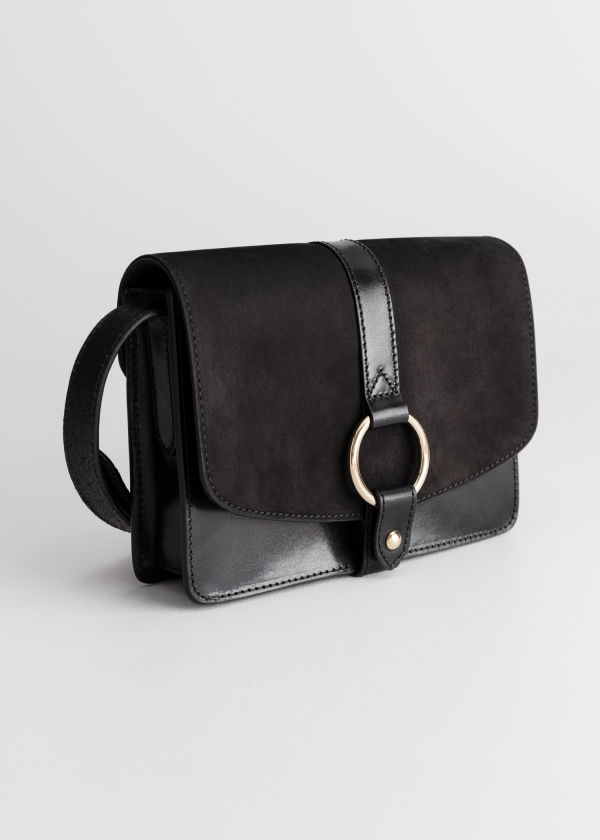 Front image of Stories gold ring leather bag  in black