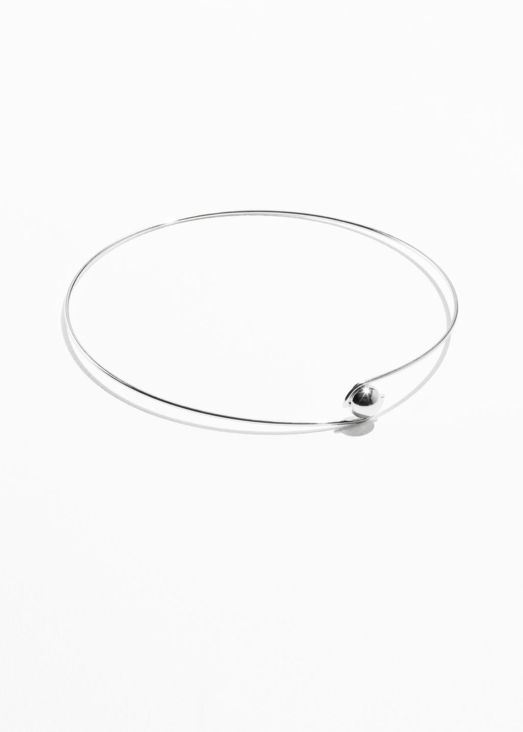Front image of Stories ball choker in silver