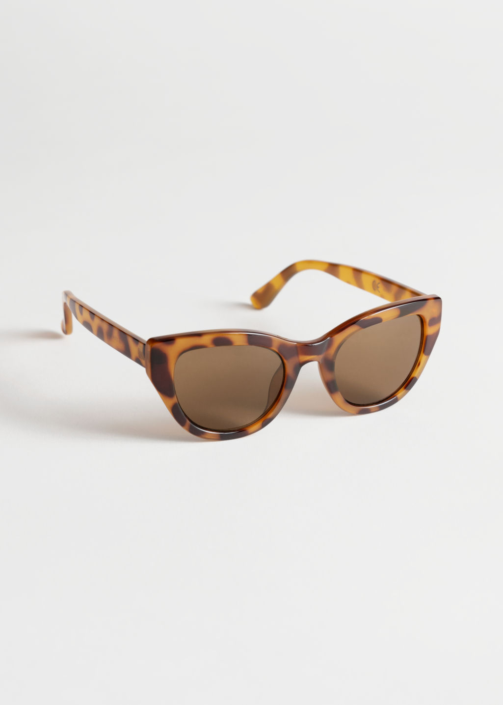 Front image of Stories cat-eye sunglasses in beige