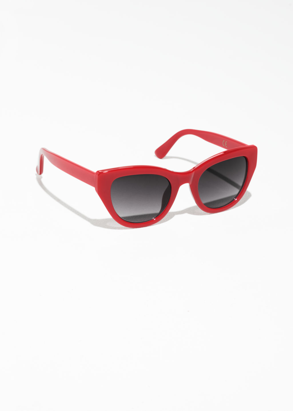 Front image of Stories cat-eye sunglasses in red