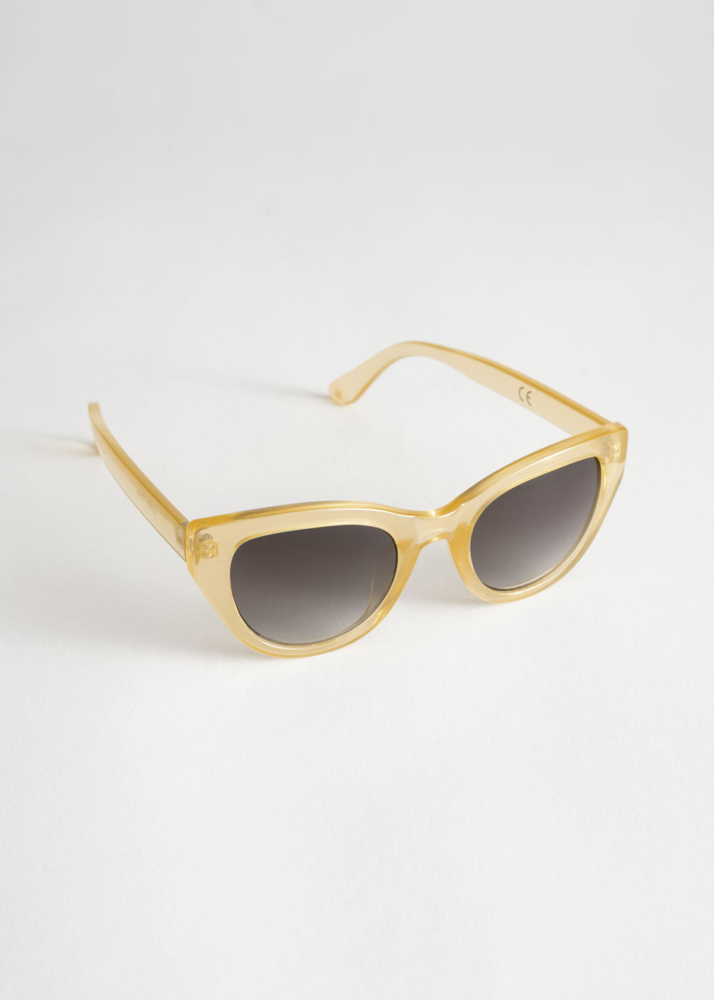 Front image of Stories cat eye sunglasses in beige