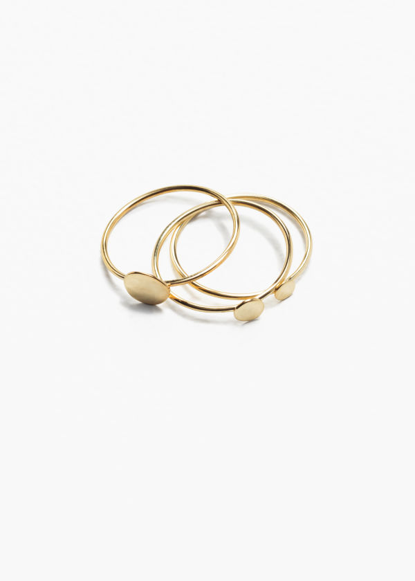 Front image of Stories charm multi rings in gold