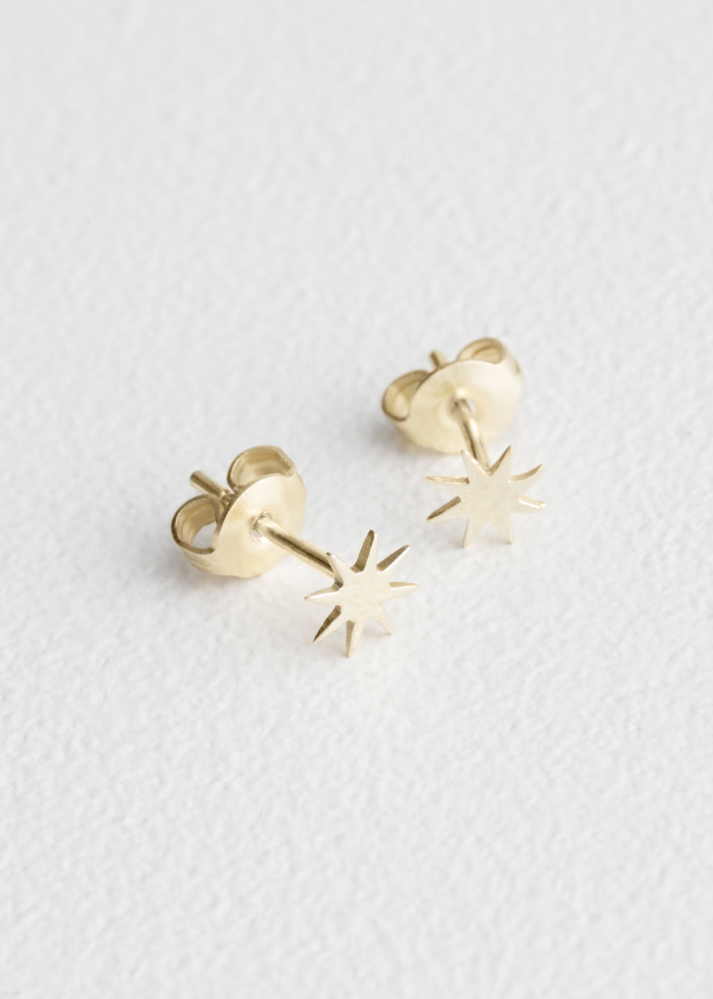 Front image of Stories star studs in gold