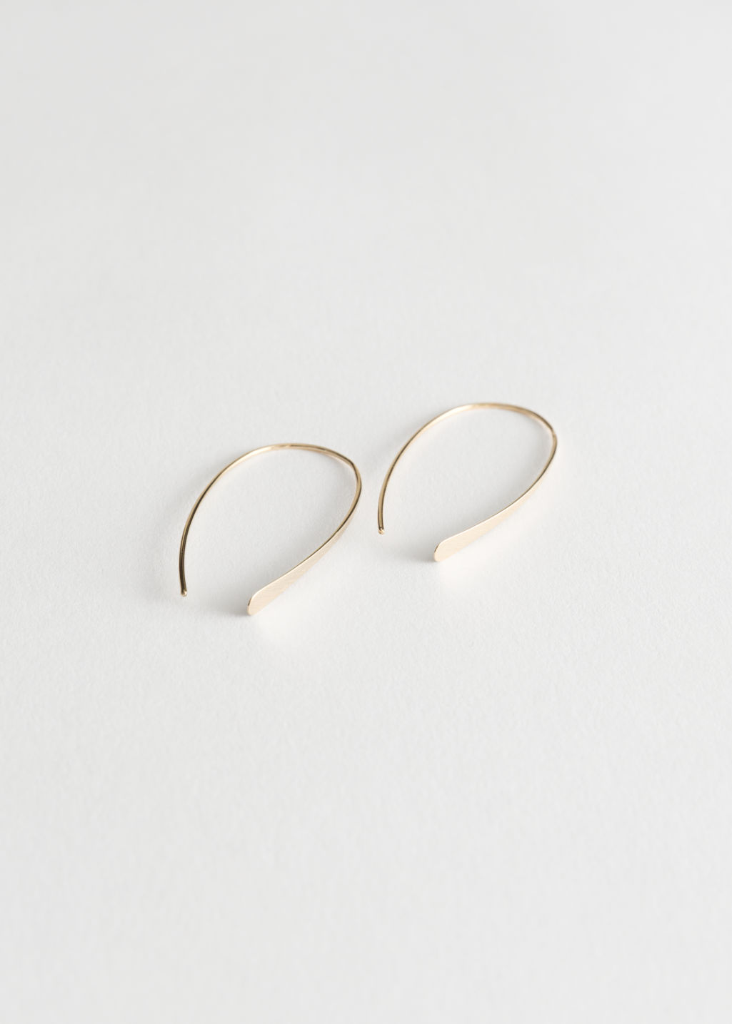 Front image of Stories semi-hoop earrings in gold