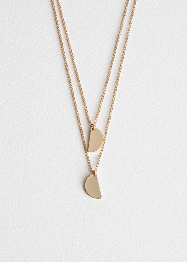 Front image of Stories half moon necklace in gold