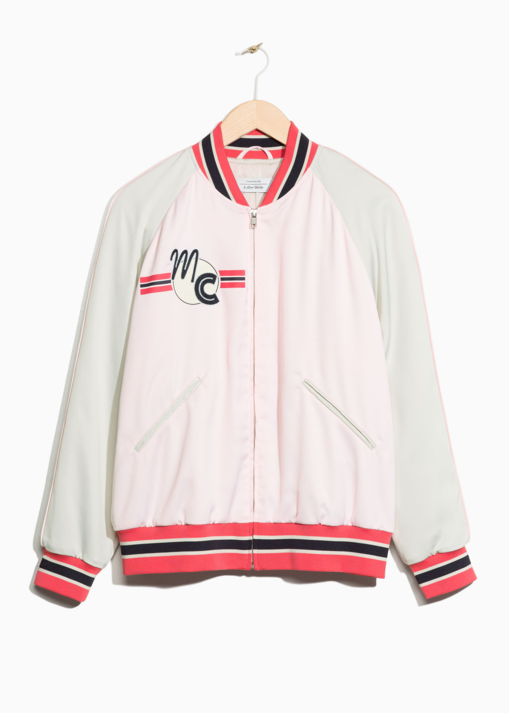 Front image of Stories patch bomber jacket in pink