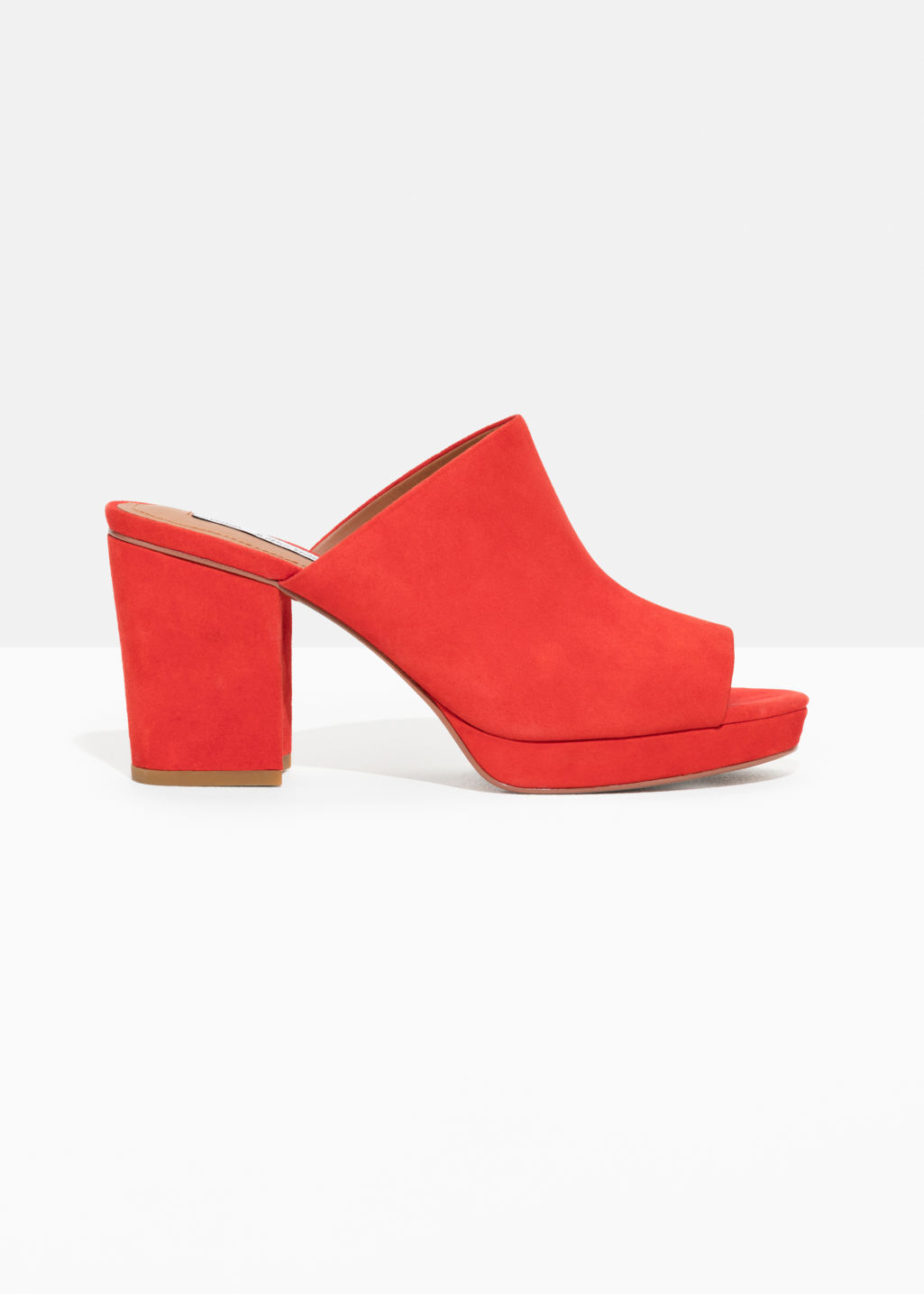 Front image of Stories suede mules in red