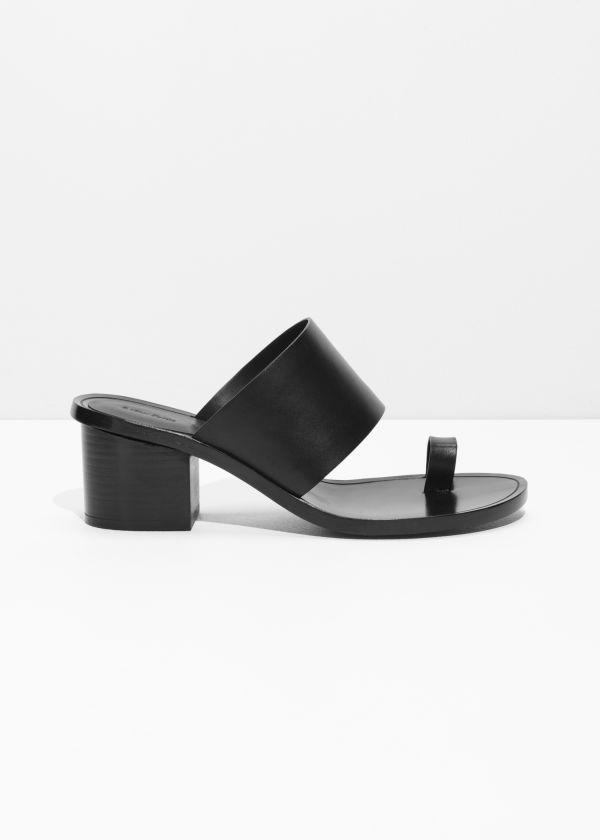 Front image of Stories toe slide sandal in black