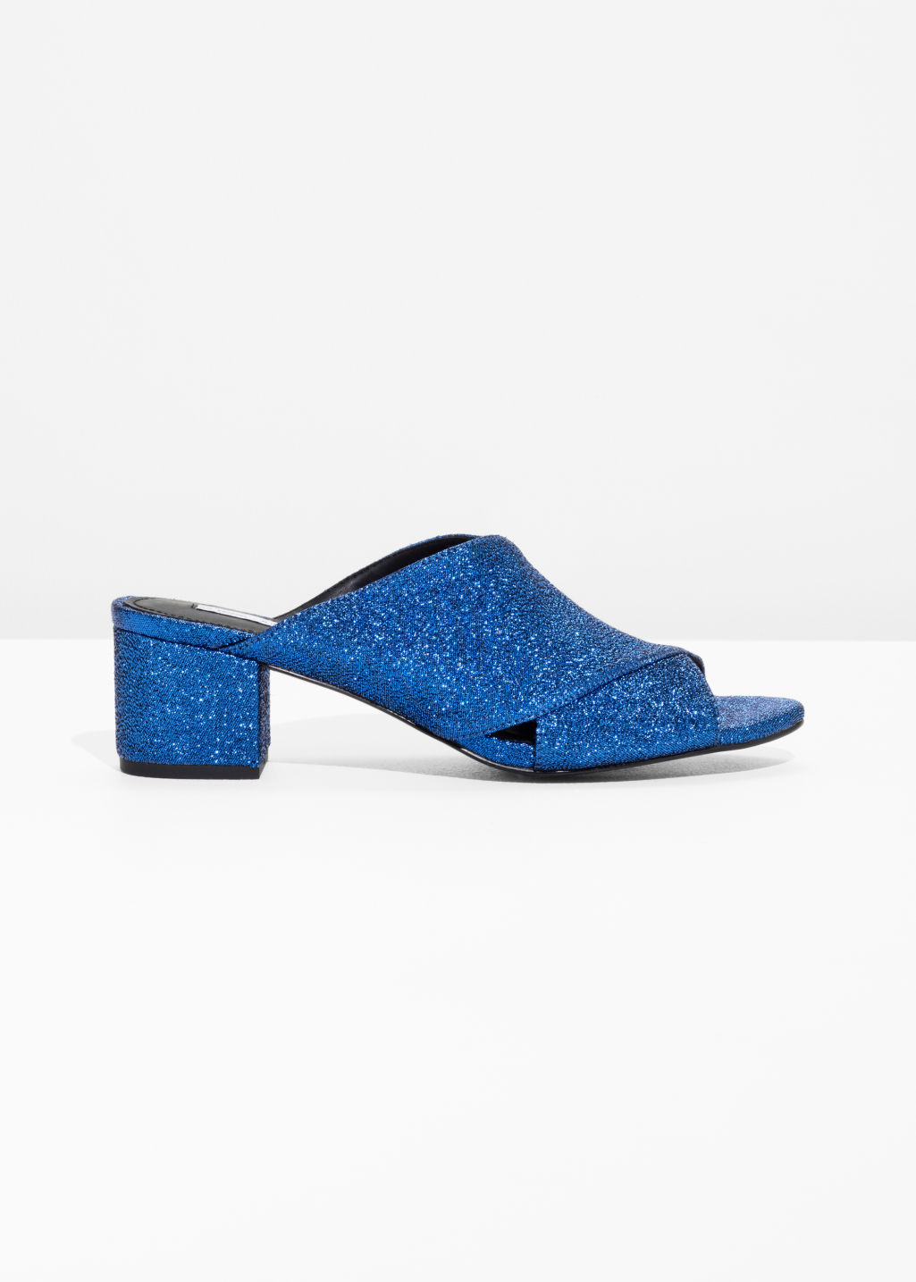 Front image of Stories cross strap sandals in blue