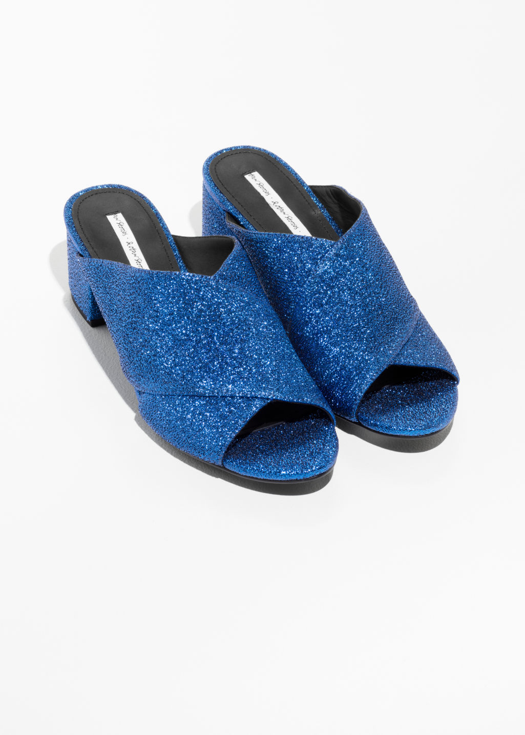 Back image of Stories cross strap sandals in blue