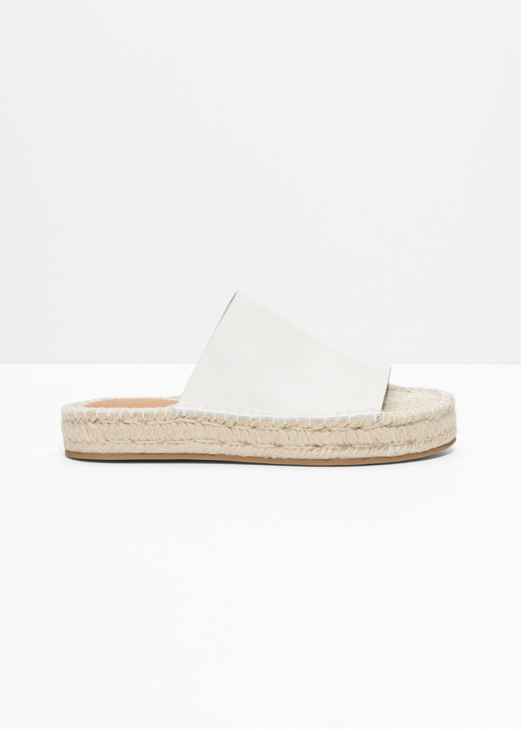 Front image of Stories slipper espadrilles in white