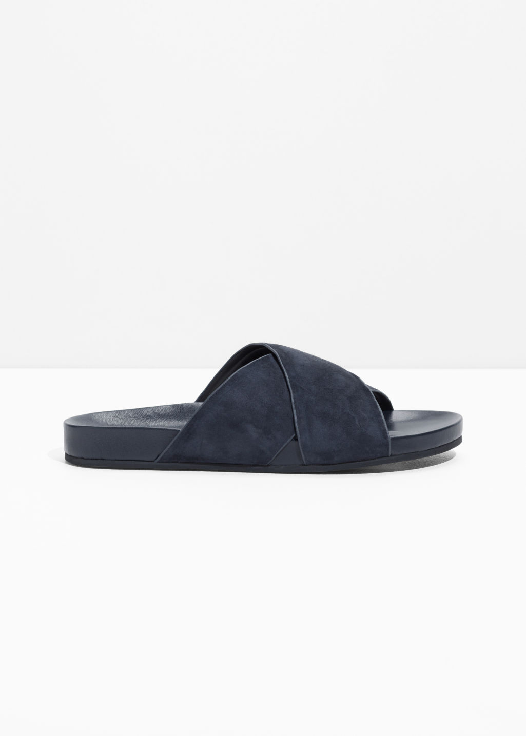 Front image of Stories wide strap suede slides in blue