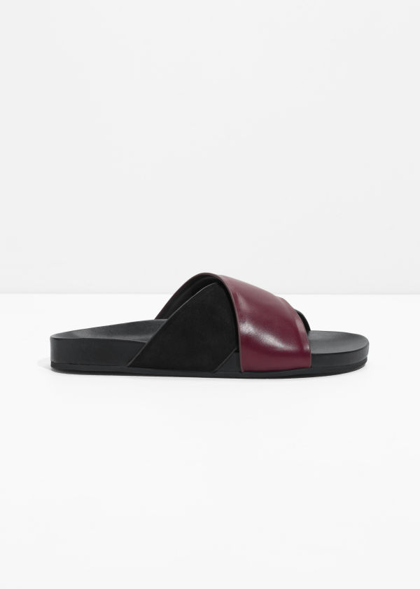 Front image of Stories wide strap suede slides in black