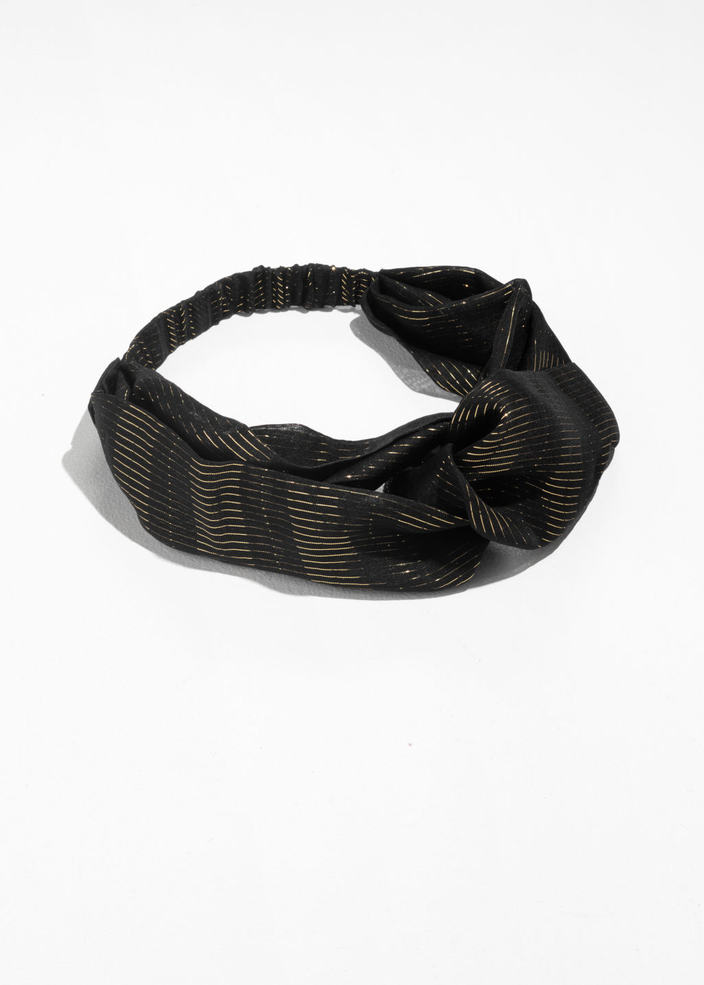 Front image of Stories twisted floral-print headband in black