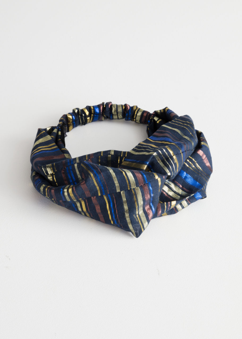 Front image of Stories twisted print hairband in blue