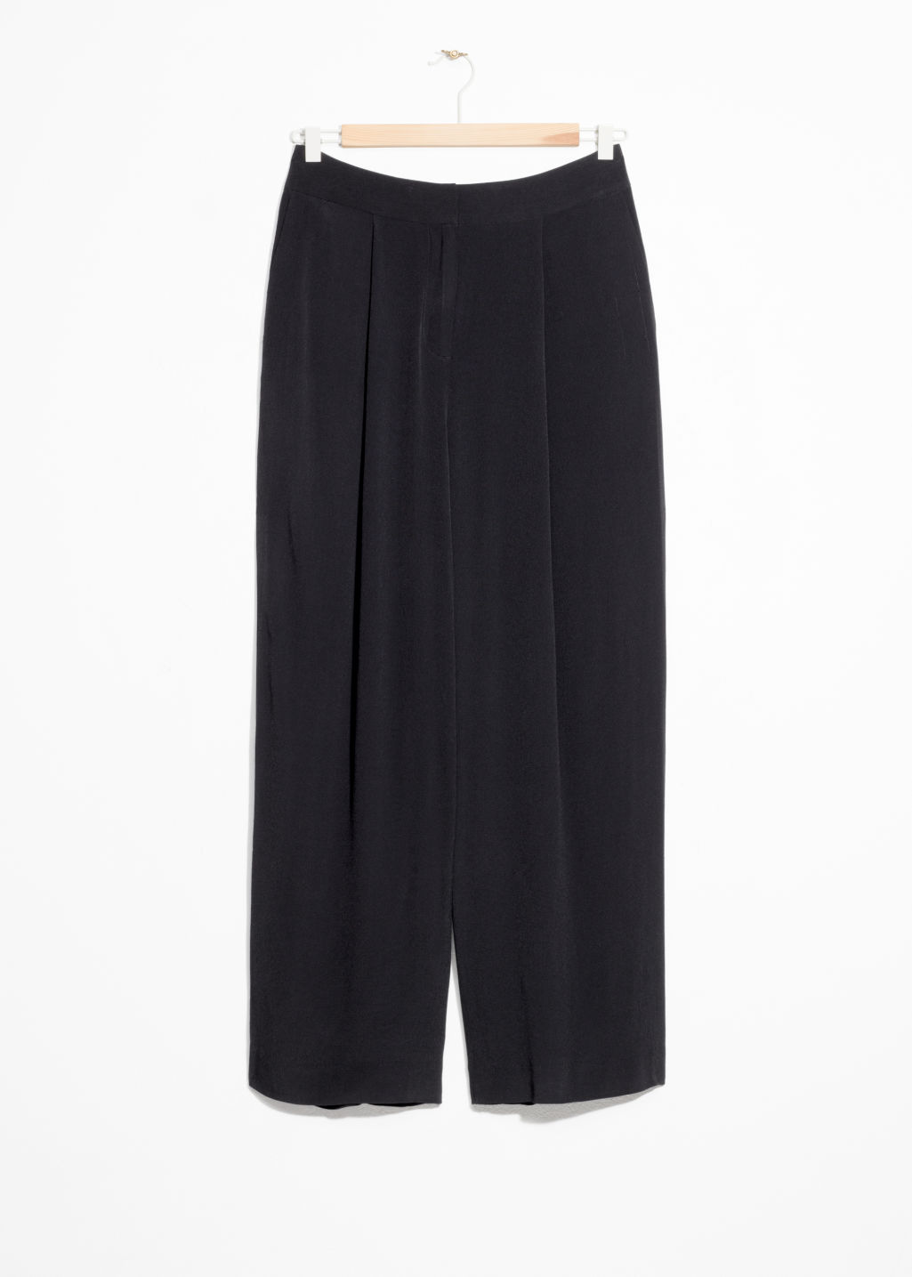 Front image of Stories wide leg trousers in black