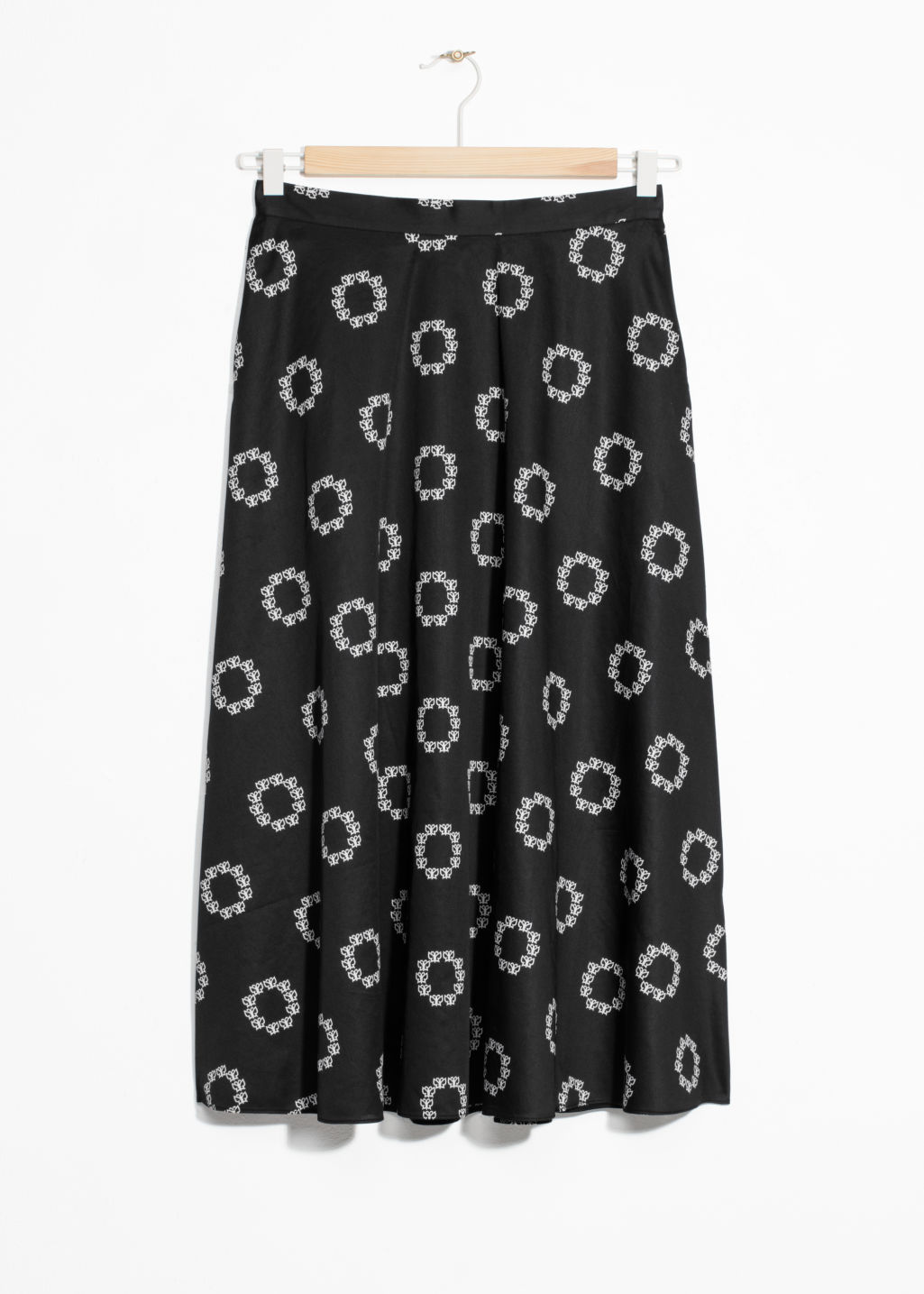 Front image of Stories painted dots a-line skirt in black