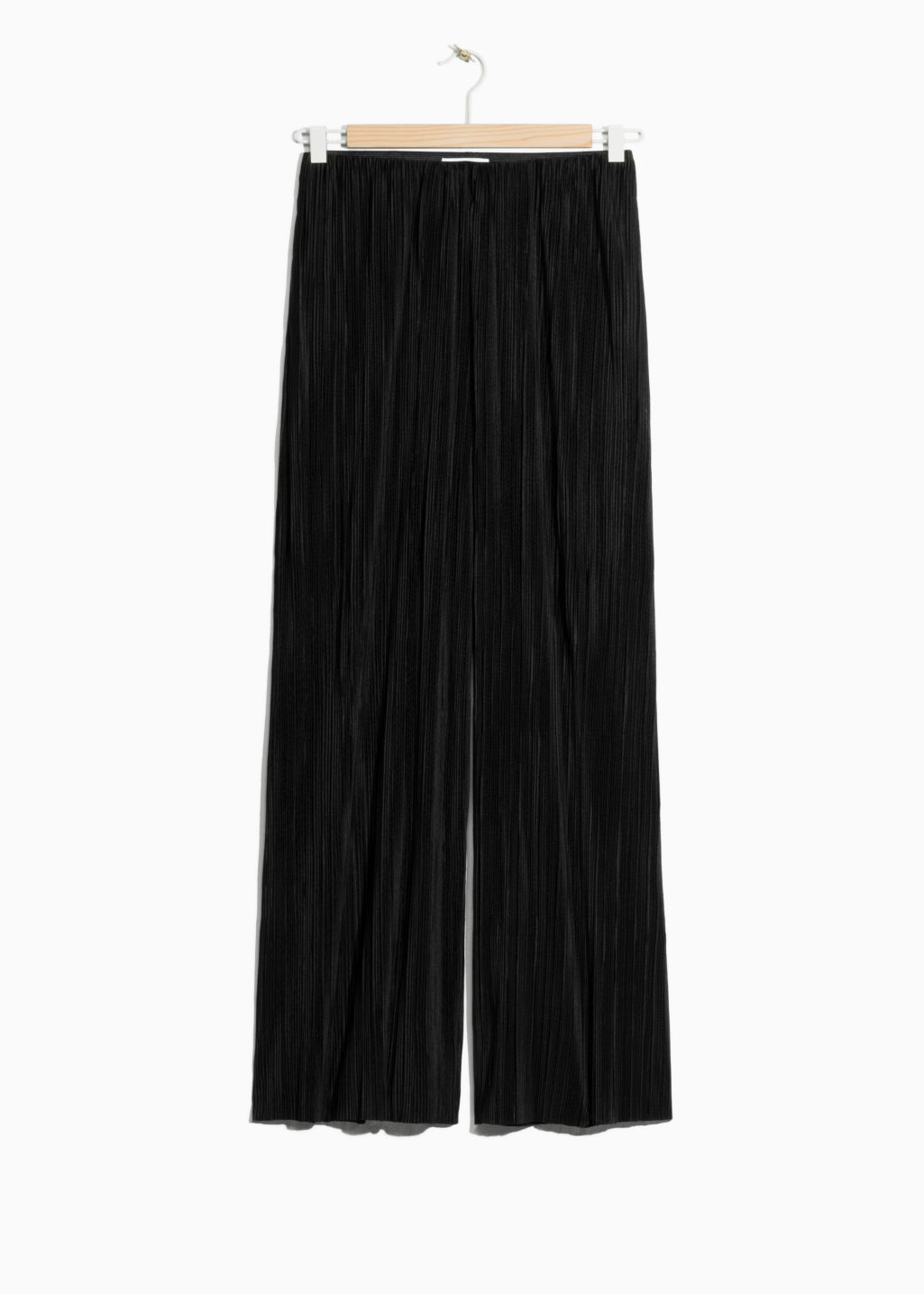 Front image of Stories pleated trousers in black