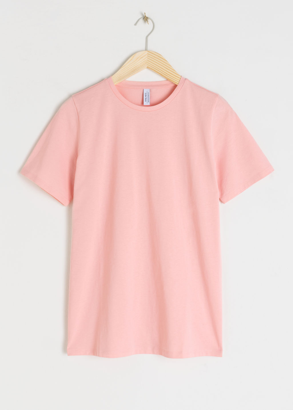 Front image of Stories crewneck organic cotton tee in pink