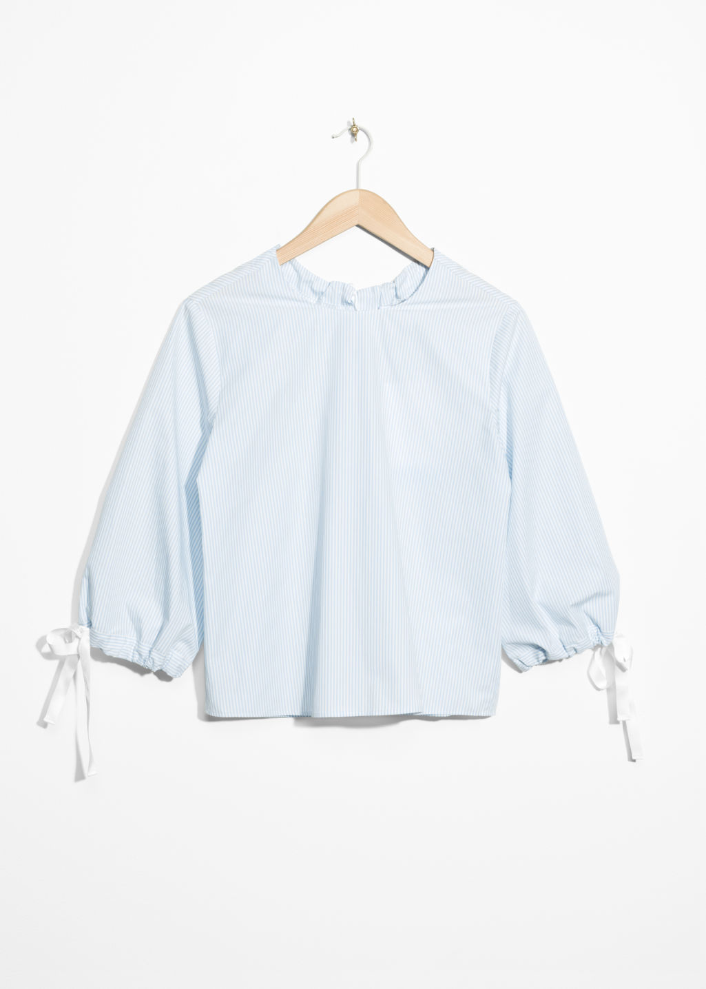 Front image of Stories tie sleeve cotton blouse in turquoise